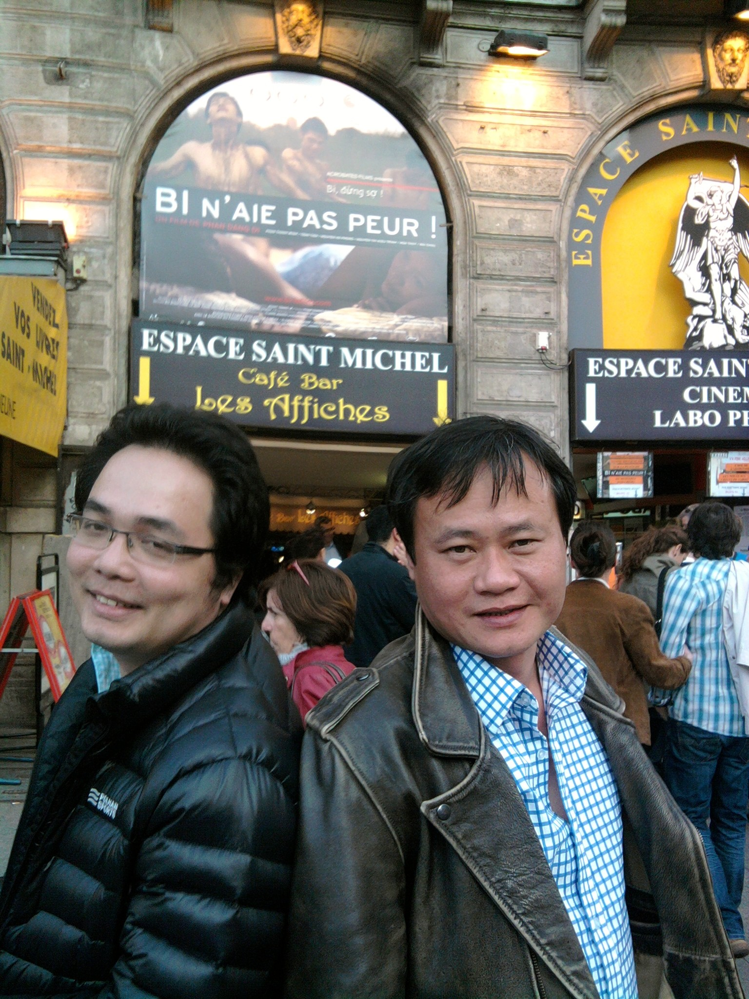 Phan Dang Di, director and Nguyen Ha Phong, actor, in a front of l'Espace Saint Michel in Paris in march 2012 for the french release of the movie. ©Arnaud Soulier